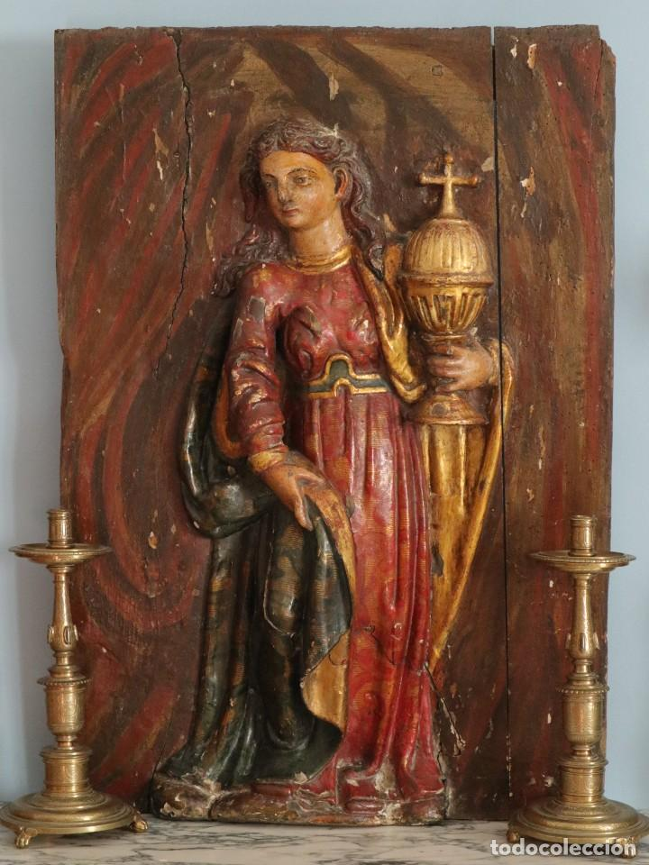 SANTA CLARA. RELIEVE DE MADERA POLICROMADA. RETABLO DEL SIGLO XVII. MIDE 81 X 67 CM. (Arte - Arte Religioso - Escultura)