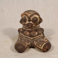 figura azteca de ceramica