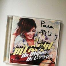 Autógrafos de Música : MERCHE - UN MUNDO DE COLORES (2012) FIRMADO AUTOGRAFIADO POR LA CANTANTE .. Lote 180340643