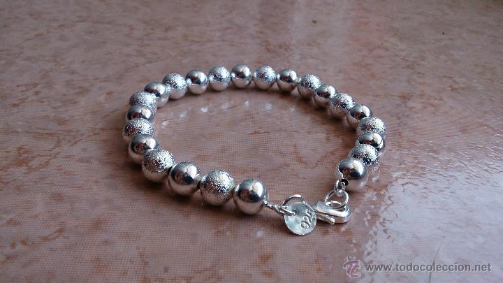 f0f44680f750 Moderna pulsera en bolas brillantes y grabadas bañada en plata de ley 925