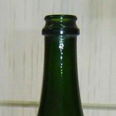 Bottiglie antiche: BOTELLA VACIA CAVA FARRÉ GARRIGA BRUT NATURAL 1ER QUINQUENI ETIQUETA ESTAÑO-FALTA UNA ETIQUETA. Lote 26985771