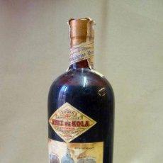 Botellas antiguas: BOTELLA, NUEZ DE KOLA ESTOMACAL, VALENCIA, TONICO DIGESTIVO ESTIMULANTE, DESTILERIAS BENEDITO, LLENA. Lote 27957488