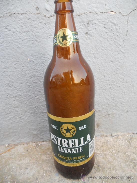 ANTIGUA BOTELLA DE CERVEZA ESTRELLA DE LEVANTE ETIQUETA EN PAPEL. 1 LITRO. (Coleccionismo - Botellas y Bebidas - Botellas Antiguas)