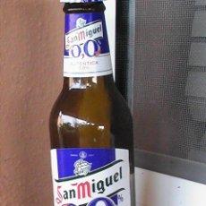 Botellas antiguas: BOTELLA DE CERVEZA SAN MIGUEL 0,0. 25 CC. ETIQUETA PAPEL.. Lote 28915928