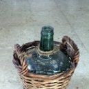 Botellas antiguas: GARRAFA FORRADA DE CAÑA. Lote 151210457