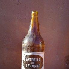 Botellas antiguas: BOTELLA DE CERVEZA ESTRELLA DE LEVANTE. 1 LITRO SERIGRAFIADA.. Lote 30032036