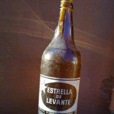Botellas antiguas: BOTELLA DE CERVEZA ESTRELLA DE LEVANTE. 1 LITRO SERIGRAFIADA.. Lote 30032143