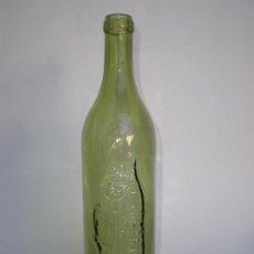 Botellas antiguas: BOTELLA *COÑAC CABALLERO* CABALLERO S.A. 186, DIBUJO Y LETRAS EN RELIEVE, COLOR VERDE. Lote 30154889