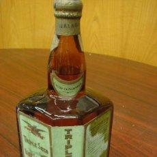 Botellas antiguas: BOTELLA LICOR TRIPLE SECO, LICOR NARANJA, PRECINTO ROTO, SIN USAR. TAPÓN DE CORCHO. Lote 32565758