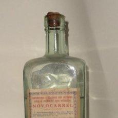 Botellas antiguas: NOVOCARREL FARMACIA SERRA REUS. Lote 36035842