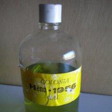 Botellas antiguas: BOTELLA DE COLONIA HENO GRANEL . Lote 110987228