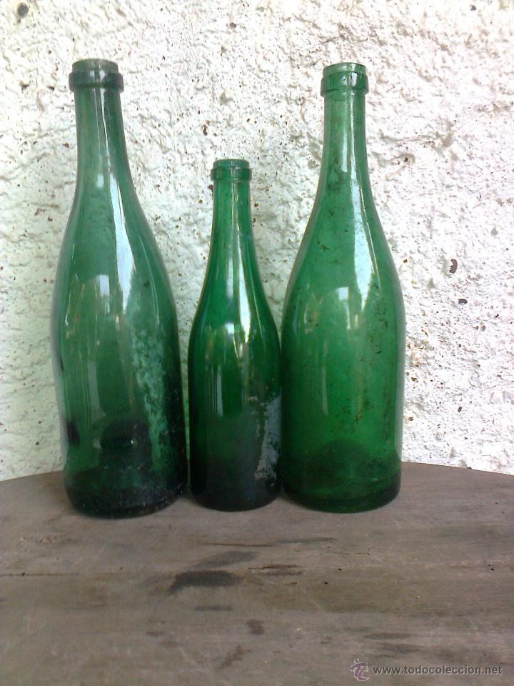 antiguas botellas cristal verde