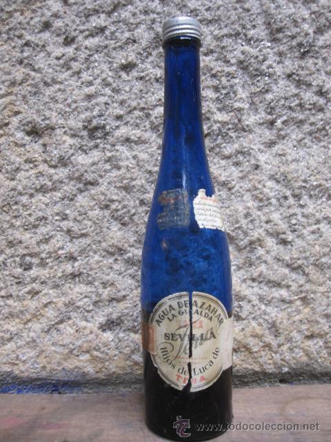 ANTIGUA BOTELLA AZUL COBALTO -AGUA DE AZAHAR LA GIRALDA - SEVILLA, HIJOS DE LUCA DE TENA, APROX 1930 (Coleccionismo - Botellas y Bebidas - Botellas Antiguas)
