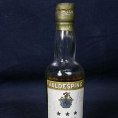Botellas antiguas: BOTELLA VALDESPINO BRANDY A.R. VALDESPINO JEREZ DE LA FRONTERA 50 CÉNTIMOS 13X3CMS. Lote 43141265