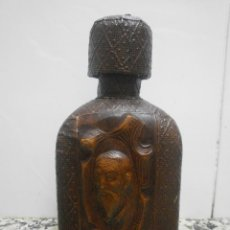 Botellas antiguas: BOTELLA DON QUIJOTE DE CUERO REPUJADO VACIA. Lote 179108820