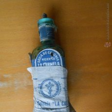 Botellas antiguas: BOTELLA AGUA DE COLONIA HIGIÉNICA LA CARMELA . LÓPEZ CARO AÑOS 30-40. Lote 47568145
