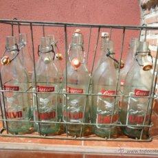 Botellas antiguas: JAULA CON OCHO CASCOS - BOTELLAS DE GASEOSA CALVO VALLADOLID 1970. Lote 48741447