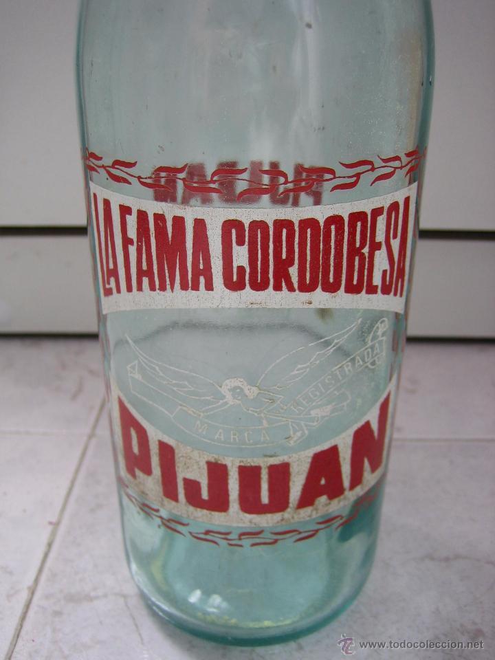 BOTELLA DE REFRESCO PIJUAN LA FAMA CORDOBESA (Coleccionismo - Botellas y Bebidas - Botellas Antiguas)