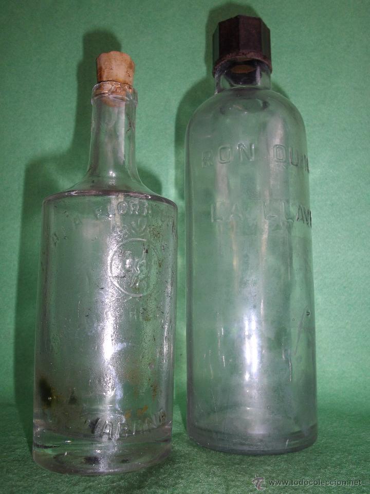 LOTE ANTIGUA BOTELLA CRUSELLAS HERMANOS FLORA CUBANA LA HABANA RON QUINA LOCION CABELLO BARBERIA (Coleccionismo - Botellas y Bebidas - Botellas Antiguas)
