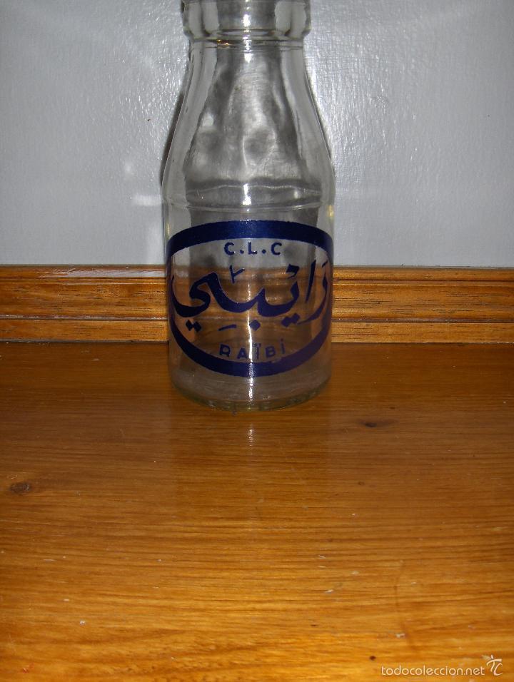 RAIBI CLC, ANTIGUA BOTELLA DE ZUMO. MANUFACTURADA POR DANONE PARA MARRUECOS. (Coleccionismo - Botellas y Bebidas - Botellas Antiguas)
