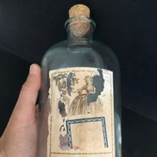 Botellas antiguas: BOTELLA DE COLONIA LOCIÓN ORDENAN. PARA LA VENTA A GRANEL. Lote 57303499