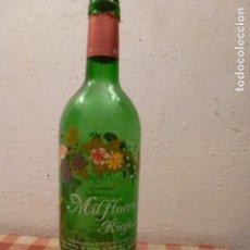 Botellas antiguas: BONITA BOTELLA VACIA DE VINO MIL FLORES. Lote 62663468
