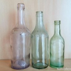 Botellas antiguas: LOTE 3 BOTELLAS RELIEVE AGUA CARABAÑA. DIFERENTES MEDIDAS. Lote 78093097