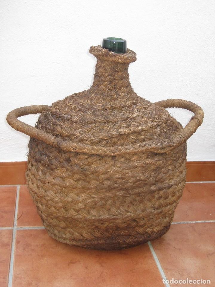 ANTIGUA GARRAFA DAMAJUANA,OVALADA-FORRADA DE ESPARTO. (Coleccionismo - Botellas y Bebidas - Botellas Antiguas)