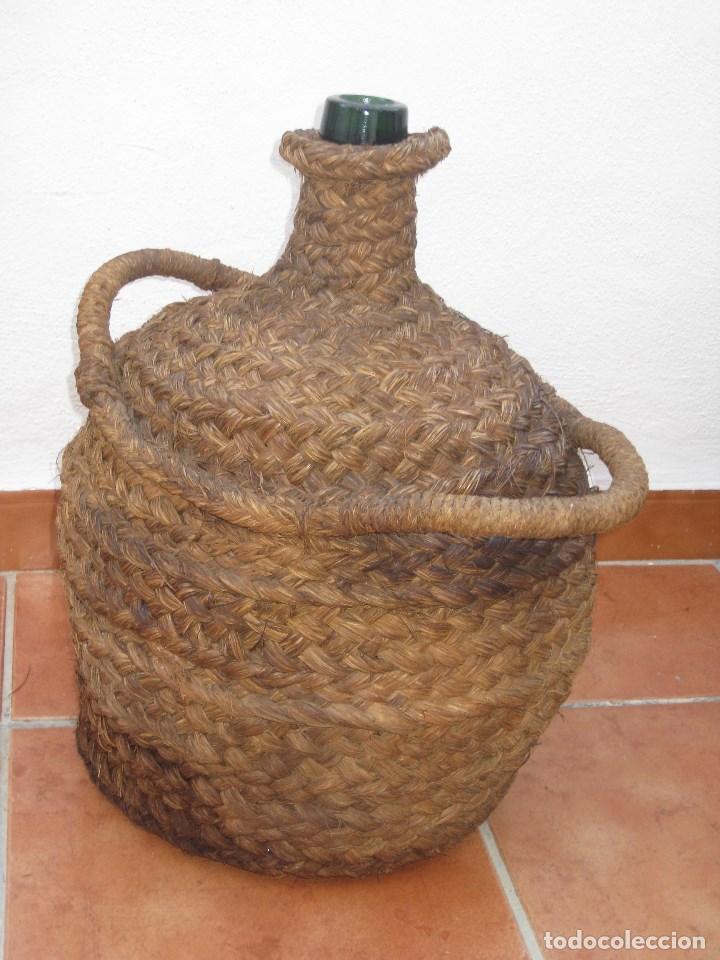 Botellas antiguas: Antigua garrafa damajuana,ovalada-forrada de esparto. - Foto 4 - 104958515