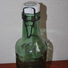 Botellas antiguas: BOTELLA DE CRISTAL CON TAPÓN DE PORCELANA - BOUTEILLES L'IDEALE - FRANCIA - PP. SIGLO XX. Lote 109408559