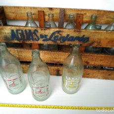 Botellas antiguas: CAJA COMPLETA DE 12 BOTELLAS AGUAS DE LANJARÓN. Lote 114740035