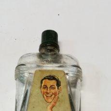 Botellas antiguas: MASAJE FACIAL GENIOL. Lote 127595287