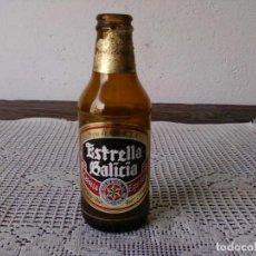 Botellas antiguas: BOTELLA ESTRELLA GALICIA 20 CL. GALICIA CALIDADE. Lote 127874243