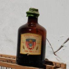 Botellas antiguas: FRASCO DE FARMACIA ESENCIA DE LIMÓN PURO // CON CONTENIDO 11 CM ALTO. Lote 130137171