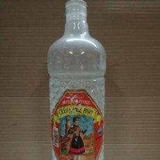 Botellas antiguas: BOTELLA DE CREMA ANIS FINO EL PICUEZO-QUEL LA RIOJA.. Lote 137109782