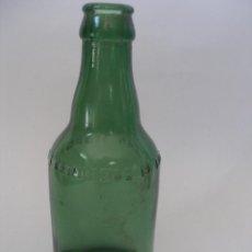 Botellas antiguas: BOTELLÍN VERDE LETRAS EN RELIEVE CERVEZA EL LEÓN SAN SEBASTIÁN. Lote 179005446