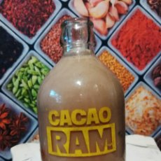 Botellas antiguas: BOTELLA DE 250CC DE BATIDO DE CACAO RAM SERIGRAFIADA. Lote 143083822