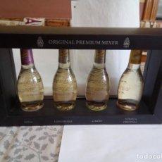 Botellas antiguas: EXPOSITOR CON 4 BOTELLAS TÓNICA SCHWEPPES . Lote 148163450