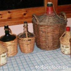 Botellas antiguas: GARRAFAS ORIGINALES DE VIDRIO DE LA CASA VIRESA FORRADAS DE MIMBRE . Lote 154131950