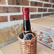 Botellas antiguas: DAMAJUANA FORRADA DE MIMBRE 1 LITRO. Lote 163119280