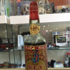 Botellas antiguas: BOTELLA BRANDY REY SOL SOLERA ANTIQUISIMA-MUY RARA Y ESCASA. Lote 169972266