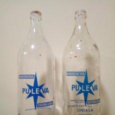 Botellas antiguas: BOTELLAS LECHE PULEVA LITRO. Lote 170570628
