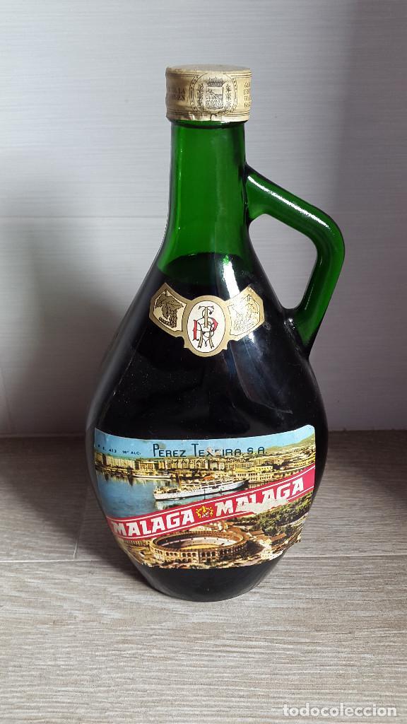 ANTIGUA BOTELLA PEREZ TEXEIRA MALAGA. VER FOTOS (Coleccionismo - Botellas y Bebidas - Botellas Antiguas)