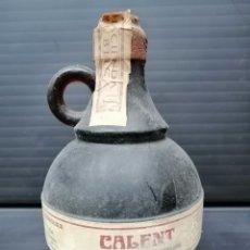 Botellas antiguas: BOTELLA LLENA DE CALENT-XORIGUER -BEBIDA TRADICIONAL MENORQUINA. Lote 207244358