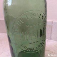 Botellas antiguas: ANTIGUA BOTELLA LECHE CONDENSADA NUESTRA DE PUIGCERDA CON TAPON ORIGINAL. Lote 209757777