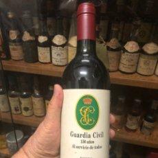 Botellas antiguas: GUARDIA CIVIL 150 AÑOS. HARO RIOJA ALTA BODEGAS BILBAINAS. CRIANZA. COSECHA 1991. 75 CL. 11,50% VOL.. Lote 215736537