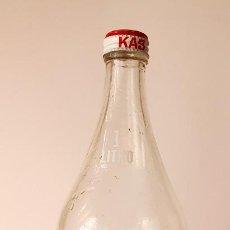 Botellas antiguas: BOTELLA 1 LITRO ZUMO DE NARANJA KAS. Lote 128023443