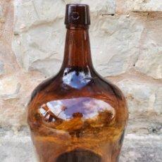 Botellas antiguas: DAMAJUANA AMBAR. Lote 219625400