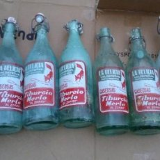 Botellas antiguas: BOTELLA ANTIGUAS DE GASEOSAS TIBURCIO MERLO LA DELICIA EL ZORRO VALDEPEÑAS LOTE DE 8 UDS.. Lote 221647147