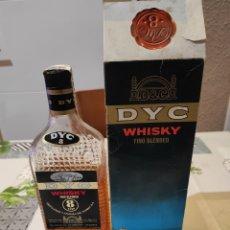 Botellas antiguas: WHISKY DYC, AÑOS 70.. Lote 248077585